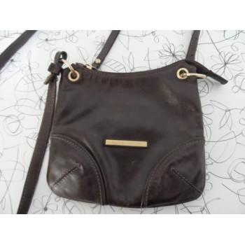 Якісна шкіряна жіноча сумка від елітного бренду Coccinelle